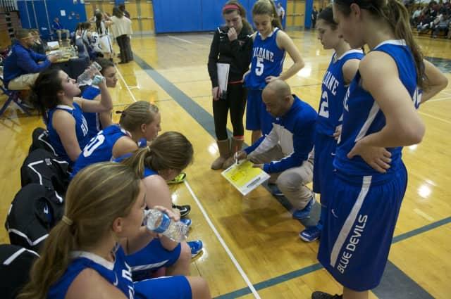 Haldane basketball coach Tyrone Searight with his team.
