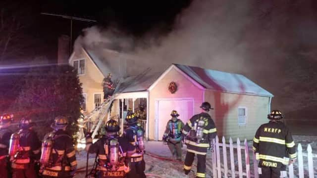 Firefighters respond to a Mount Kisco house fire on Spring Street.