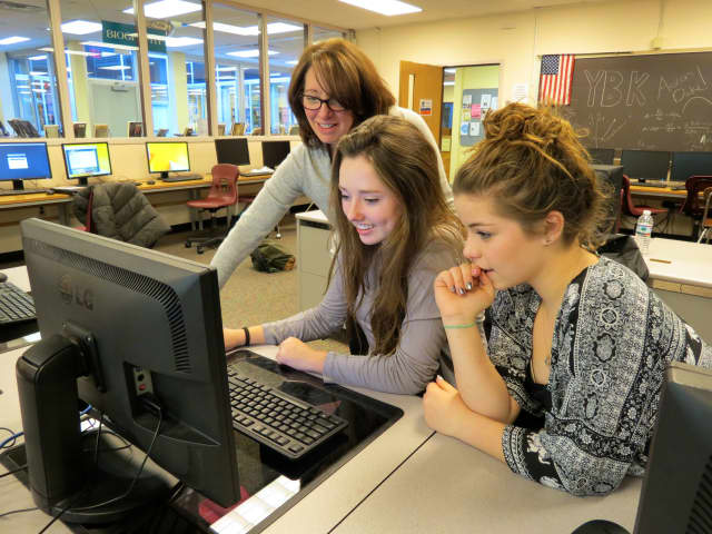 Briarcliff High School Yearbook Club adviser Nina Marcel worked with student staff members on layout decisions for the 2015 publication.