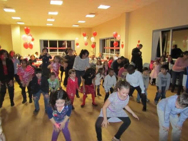Parents and children have fun at a previous Valentine's dance.