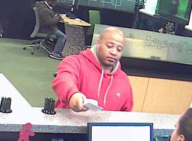 New York State Police need help identifying the man pictured, who is wanted for questioning regarding a bank fraud case.