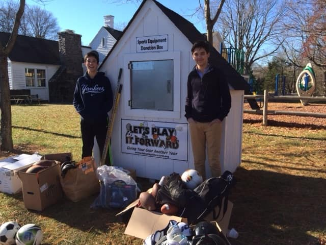 (L-R) Paul Hartigan (Hendrick Hudson freshman) and Victor Podvalny (freshman at Xavier High School in New York City) at the collection shed for Let's Play It Forward in Somers.