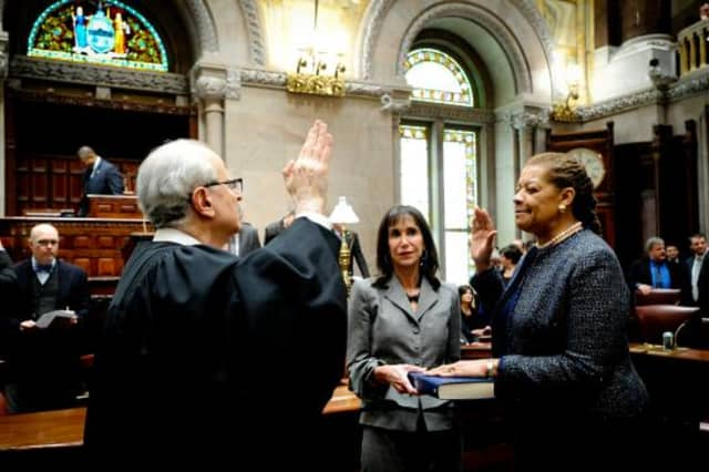 Senator Ruth Hassell-Thompson is sworn into office by the Honorable Jonathan Lippman, Chief Judge of the State of New York while Honorable A. Gail Prudenti, the Chief Administrative Judge of the Courts, holds the Bible.