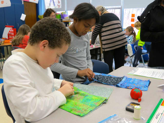 Croton-Harmon fourth-graders sewed Colonial-style four square pillows as an introduction to a unit about early American history.