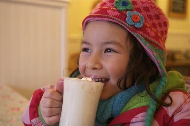 Kona Lahire, 5, of Mamaroneck, samples the white chocolate hot chocolate at Larchmont's Voracious Reader.