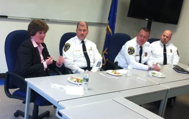 """Special Agent in Charge of the FBI in Connecticut Patricia Ferrick speaks during the """"Lunch With The Chief"""" at the New Canaan Police Department. Also pictured from left are: Capt. Vincent Demaio, Chief Leon Krolikowski and Capt. John DiFederico."""