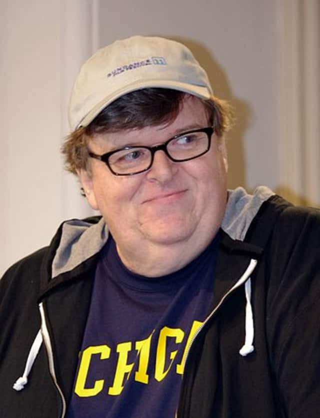 In a speech Friday, filmmaker Michael Moore lambasted Sarah Lawrence College officials' response to a building workers union forming on campus, according to lohud.com.