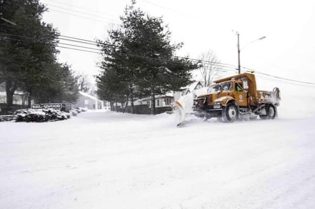 A plow clears a road in Bridgeport on Tuesday.