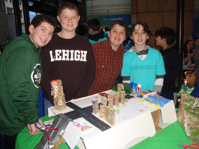 """Briarcliff Middle School eighth-grade Future City Club team members (from left) Ben Harris, Josh Ross, Nick Sama and Max Hertz (Caleb Schumacher not pictured) with their award-winning model city, """"Goatlantis."""""""