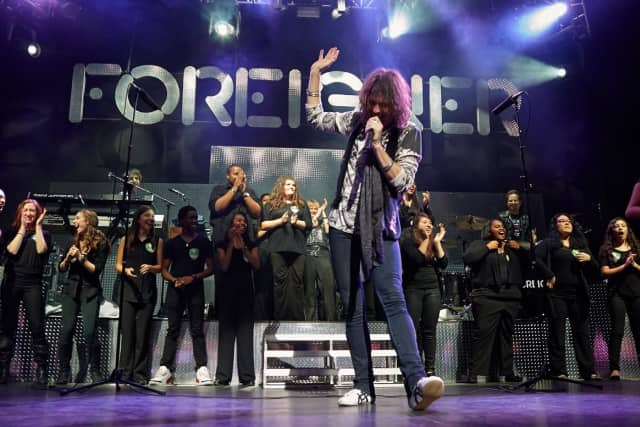 Foreigner performed with the Port Chester High School Choir in 2014.