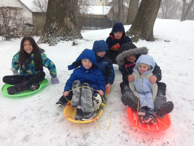 Port Chester kids enjoying the snow at Abendroth Park.