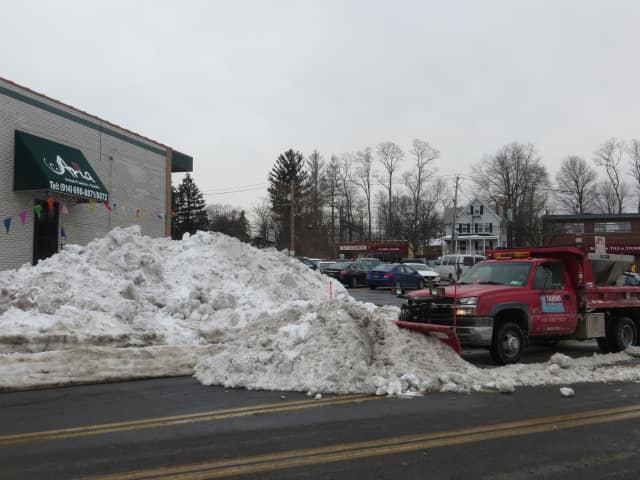 This plow cleared snow in Harrison last winter. This season's largest snowfall is expected this week -- prompting traverls' warnings on Wednesday and Thursday.