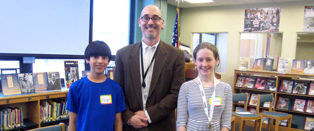 Phoebe Streeter and Angel Chavez-Ferreira, the final two Louis M. Klein finalists of the Geography Bee with Principal Scott Fried.
