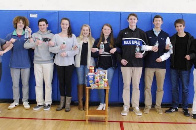 The Darien Youth Commission will attempt to break the Guinness World Record for longest arm-linked toast on Saturday.