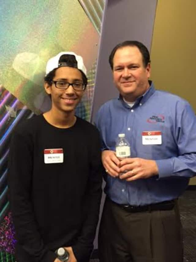 Mentor Neal Konstantin, right, celebrates with Mentee  Michael Hidalg of Nathan Hale Middle School as The Human Services Council of Norwalk honored mentors and mentees in the Norwalk Mentor Program last week.