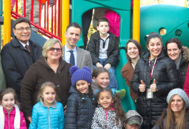 Park Childhood Center students, school officials and developer Martin Ginsburg, far left, at the center's new playground.