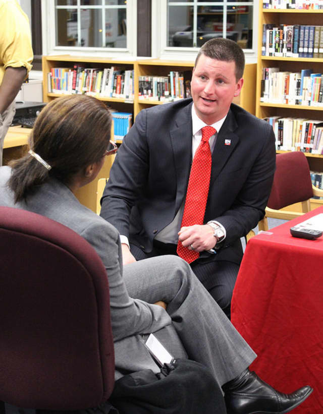 Superintendent Joseph Ricca talks to a parent during his Coffee and Conversation meeting at the high school.