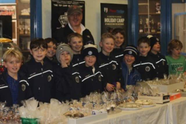 The Darien Youth Hockey Squirt A1 team held a bake sale fundraiser to support Jeremy and Miles, Darien boys who suffer from a debilitating disease, Dravet syndrome.