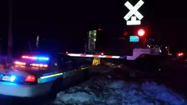A freight train collided with a vehicle in Middlesex County.