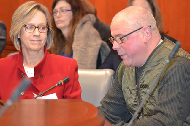State representative Terrie Wood, left, and Darien Cheese and Fine Foods owner Ken Skovron testified at Wednesday's hearing.