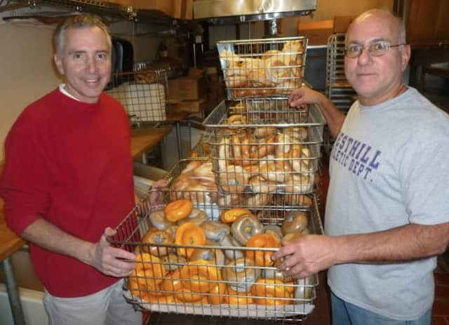 Anthony and Peter Telesco standing by bagels at their Liz-Sue bagel shop in Stamford.