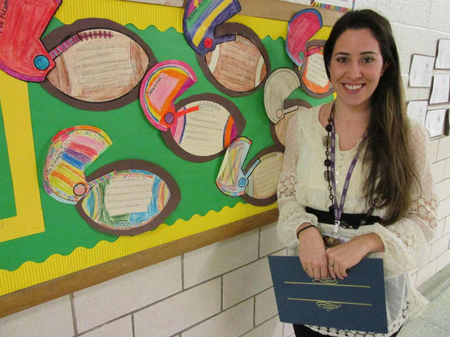 New Rochelle High School teacher Marianna Trombetta was recommended for tenure at a recent meeting.