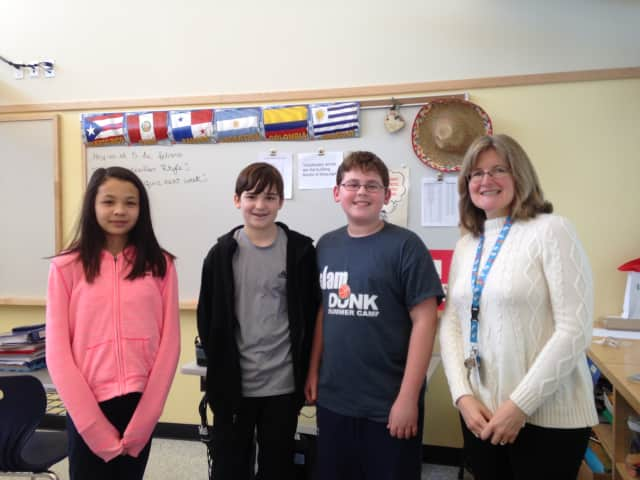 Pictured from left to right are Eastchester Middle School students Sakura Abdel-Rahman, Kevin Walsh, Austin Summer and teacher Mary Leptak.