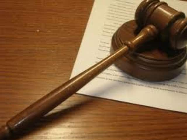 Two former Danbury residents were sentenced for their roles in a money order fraud scheme.