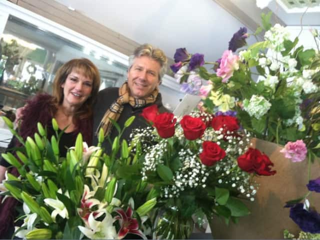 Floral designers Debbie Valentine and Gregg Fisk said Valentine's Day is one of the busiest of the year. They work at New Canaan Florist, Garden & Gifts.