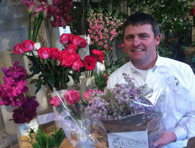 James McArdle III, owner of McArdle's Florist & Garden Center, at 48 Arch St., stands with some popular flower selections for Valentine's Day. It is one of the busiest days of the year for the 105-year-old business.