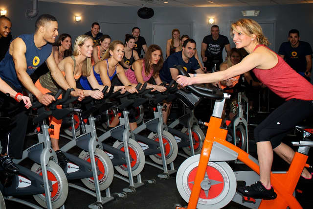 Rhodie Lorenz leads an indoor cycling class at JoyRide in Darien.