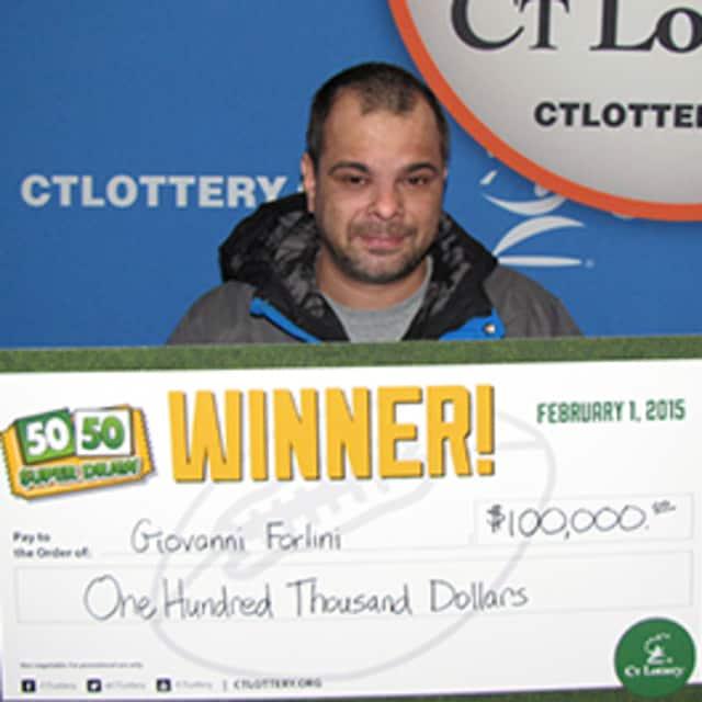 Giovanni Forlini with his ceremonial  $100,000 check.
