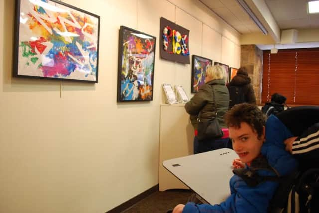Pines Bridge student Perry McNiff of Rye Neck visits the Katonah Village library to see some of the paintings he and other Pines Bridge students had created.