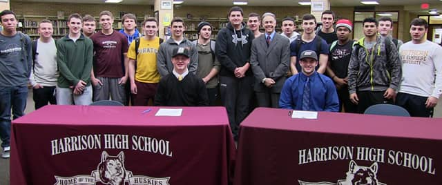 Harrison High School football players Drew Estes and Christian LoDolce recently signed Letters of Intent to play in college.