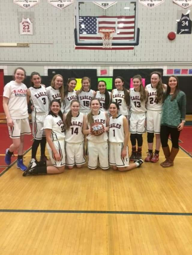 Eastchester's Olivia Heffernan was joined by her teammates to celebrate her 1,000th career point.