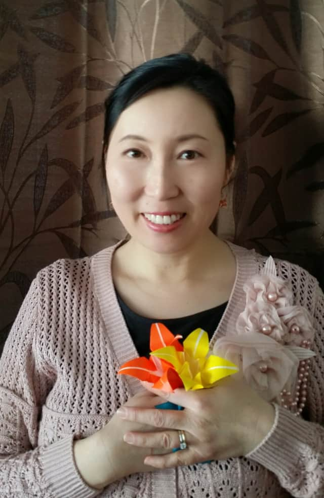 Julie Tang, here with a piece of origami, will lead a workshop with the Larchmont Garden Club on Monday.