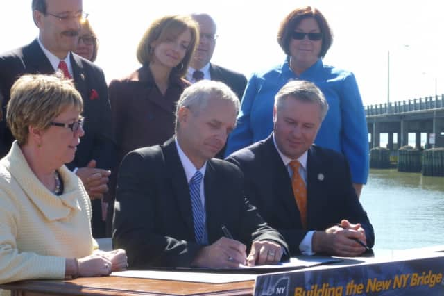 Federal and state officials sign the official record of decision for the Tappan Zee Bridge project in Nyack Tuesday morning.