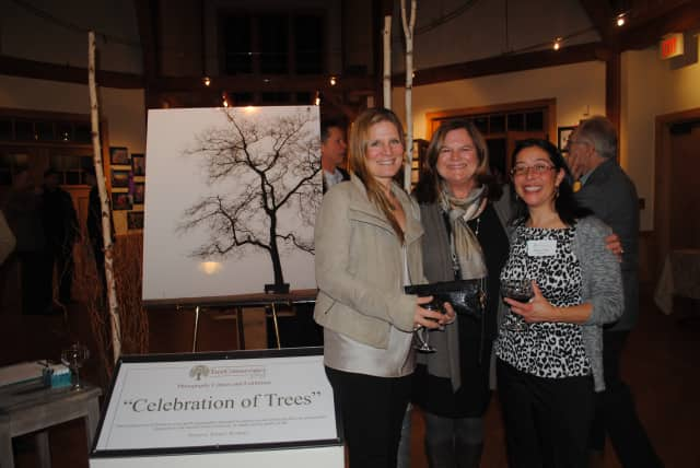 Pictured at last year's reception are Andrea Bonfils, and Tree Conservancy of Darien board members Karen Hughan and Sabina Harris.