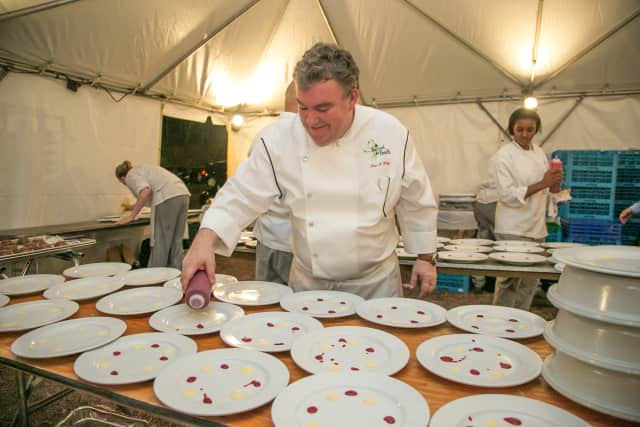 Chef Peter X. Kelly prepares for an event.