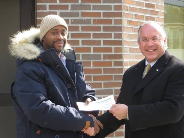 From left, ECAP Director Don Brown and Eastchester Supervisor Anthony S. Colavita with the town's annual grant check to the organuzation.