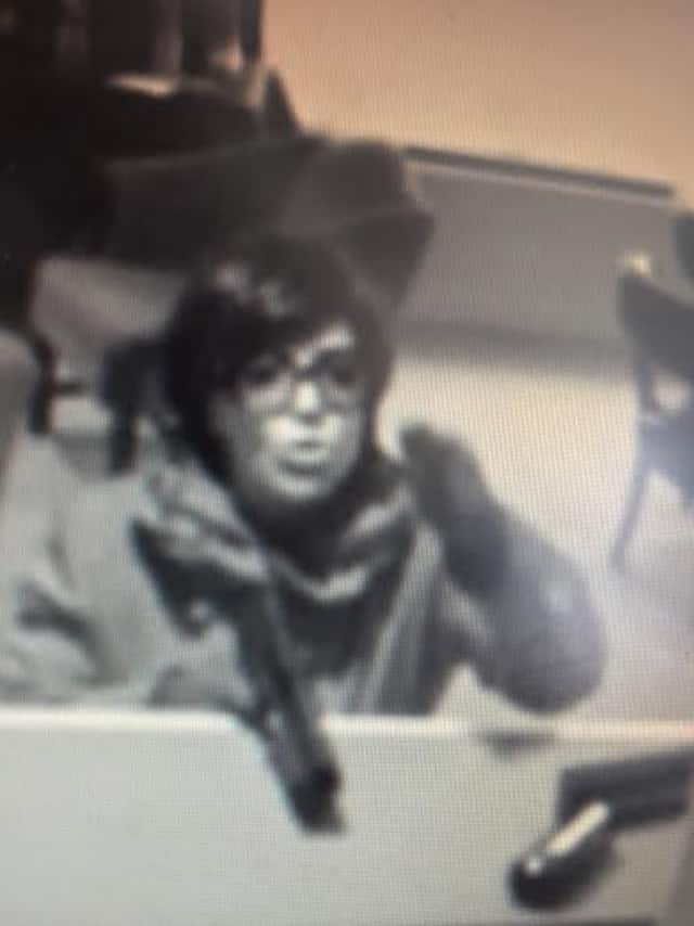 A picture of the woman robbing the Greenwich Bank & Trust Company on Jan. 30. A woman has been arrested by the FBI in New Jersey in connection with a bank robbery there. Police are investigating whether the two may be linked.
