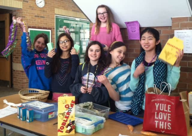 Irvington Middle School French Club students celebrated National French Week by engaging the school community in a number of cultural activities, which helped raise $5,000 for Doctors Without Borders.