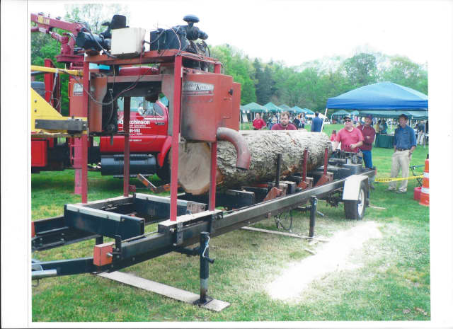 George Bell of Cut 'N' Dry Sawmill in Norwalk, shown here making boards out of an oak log, is a regular exhibitor at the Connecticut Tree Festival.