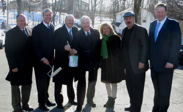 """Pictured left to right: Supervisor Colavita, Jim Coleman, Gerry Houlihan, Joe Houlihan, Patricia Houliha, John Collins and Brendan Lynch at the ceremonial painting of the """"Green Line."""""""