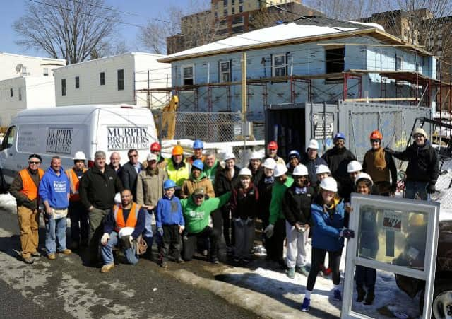 "Murphy Brothers Contracting of Mamaroneck joined forced with other businesses and Iona College students to install 20 windows at a ""Home for Heroes"" project in Yonkers."