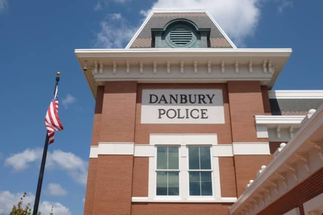 Two Danbury men were arrested after police said they broke into a car outside the police station.