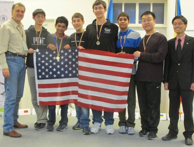 Greenwich High School junior Michael Kural, center, received one of 10 Gold Medals in the 2015 Romanian Master of Mathematics (RMM) competition. The international competition was held in Bucharest, Romania from Feb. 25 to March 1.