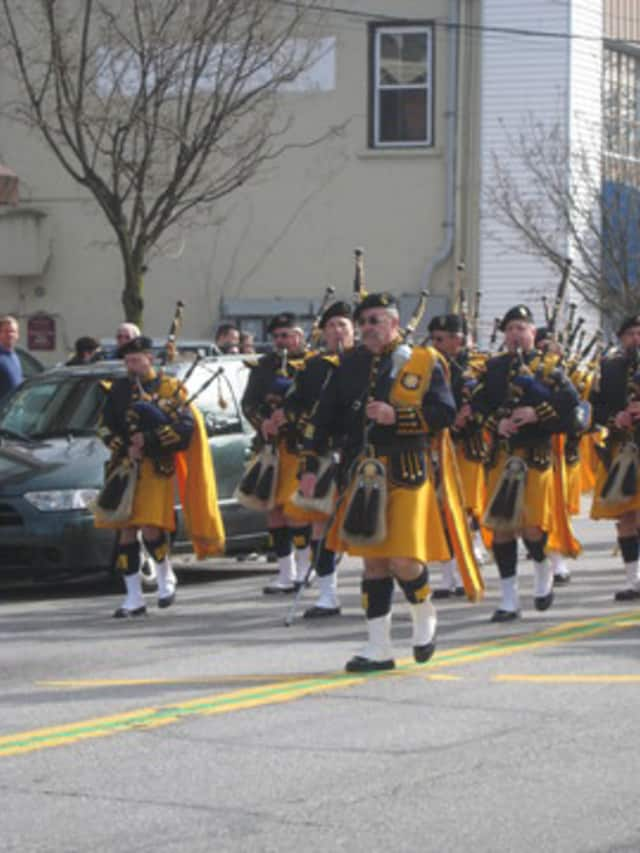 Bagpipers at a St. Patrick's Day parade in downtown Mount Kisco.