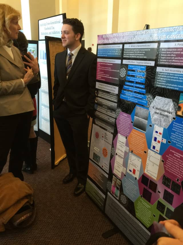 Hendrick Hudson senior Jazz Munitz is shown presenting his poster that placed third at the Upstate New York Junior Science and Humanities Symposium.