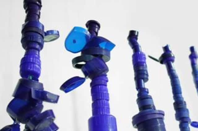 """Co-Mingle Complements, 2014-15, plastic bottle caps, 7' x 6' x 3""""."""